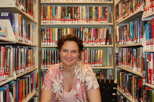 Gianna Gregorio in her favorite section of the East Hampton Library: the graphic novel section. JON WINKLER