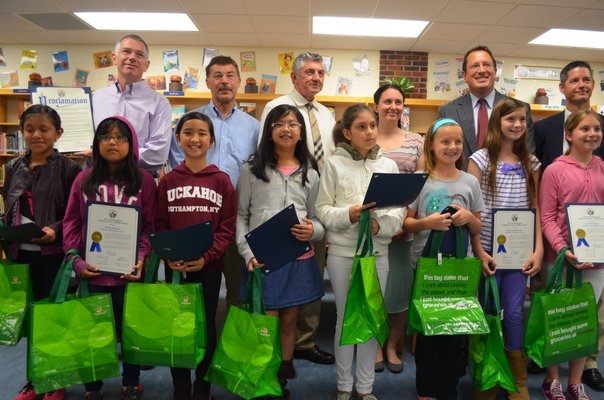 Winners of the Solutions In the Bag-The Greener Southampton contest from Tuckahoe School pose with the Board of Education. BY ERIN MCKINLEY