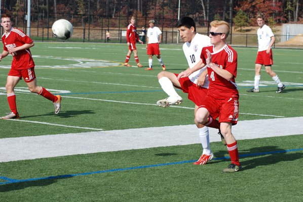 Pierson junior Jesus Padilla sends the ball forward in front of Southold senior Ryan DiGregorio. DREW BUDD