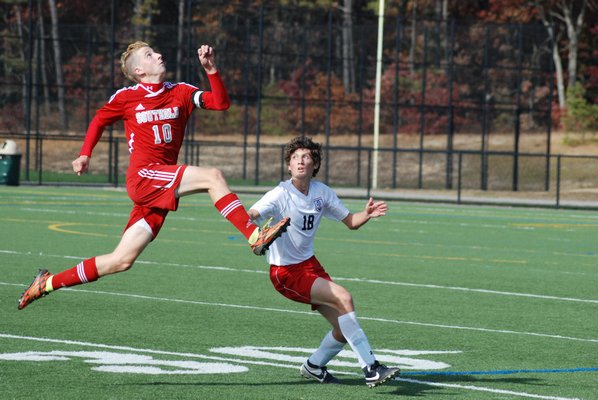 Southold senior Shayne Johnson and Pierson freshman Sam Warne go for a ball in the air. DREW BUDD