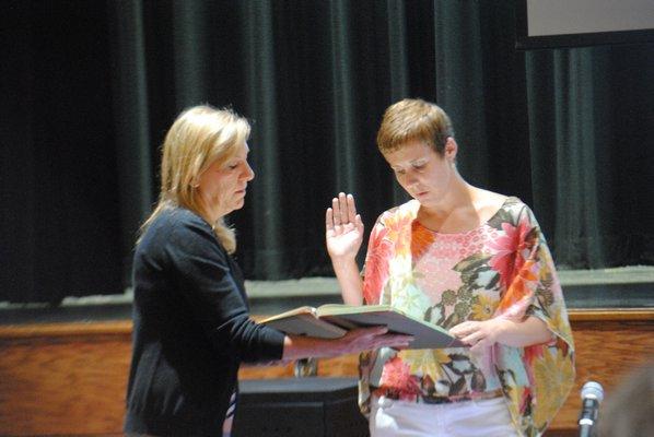 Elizabeth Scully was sworn into office by Anna Rojas, district clerk. AMANDA BERNOCCO