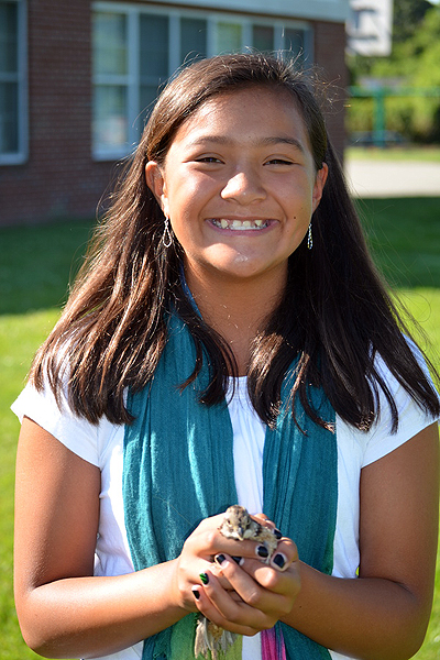 Sixth grader Grace O'Hare with a quail. ERIN MCKINLEY