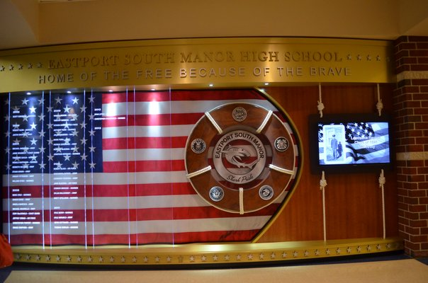 The Wall of Honor at Eastport South Manor Junior-Senior High School was completed in February of 2013. The names of ESM graduates in the armed forces were added for the dedication ceremony last week. Alexa Gorman