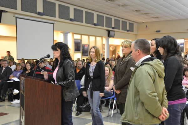 Marie Patton, the parent of a special education student, addresses the Eastport South Manor Board of Education as parents of students with special needs, look on. LAURA COOPER