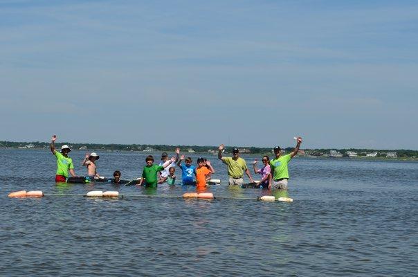 Volunteers anchored their oyster farm on the bay side of Lashley Beach on Saturday. Alexa Gorman