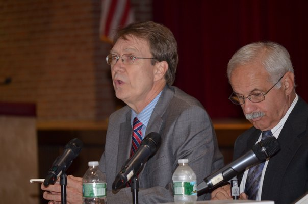 Doug Exley, left, and Sam Shevat of the SES Study Team presents findings at the merger forum at Southampton High School on Wednesday night. BY ERIN MCKINLEY