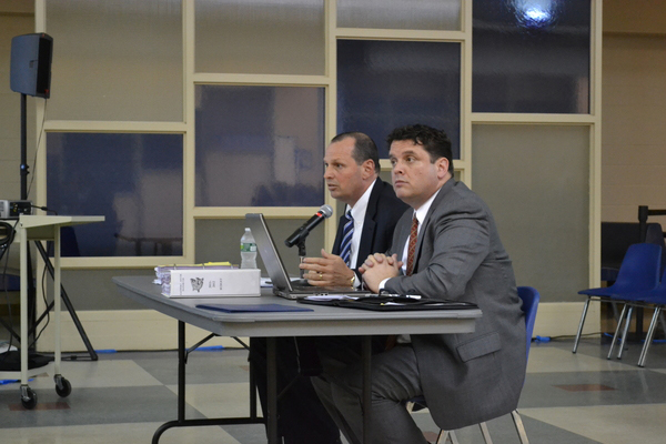 Eastport South Manor Superintendent Mark Nocero and Assistant Superintendent of Business Richard Snyder present the completed budget to the school board at it's April 13 meeting. The budget was adopted soonafter.