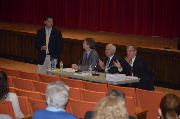 Southampton Superintendent Dr. Scott Farina, standing, with SES Study team members Doug Exley, left, Sam Shevat, and Paul Seversky, right, at the merger forum at Southampton High School on Wednesday night. BY ERIN MCKINLEY
