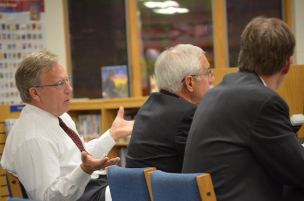 Hampton Bays Superintendent Lars Clemensen reads the motion for the school board to adopt the district's 2011-2012 budget.