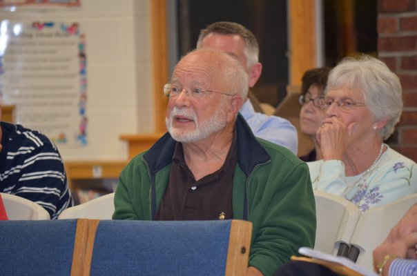 Bill Dalsimer addresses the panel at the merger study meeting held at the Tuckahoe School on Thursday. BY ERIN MCKINLEY