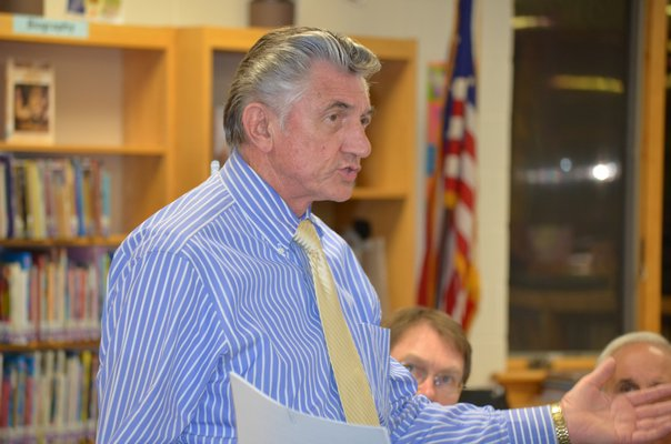 Board of Education President Bob Grisnik addresses the community at the merger study meeting held at the Tuckahoe School last week. BY ERIN MCKINLEY