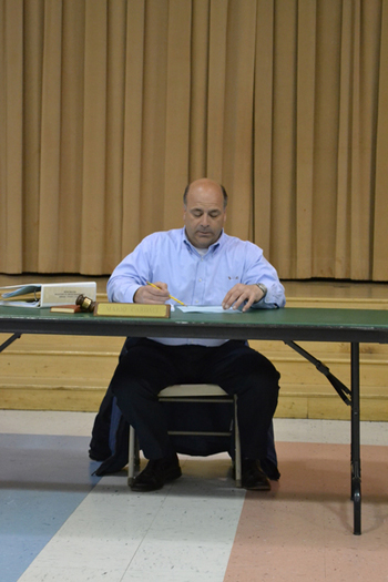 East Quogue School Board President Mario Cardaci addresses the public at a special meeting of the School Board on Monday, April 18.