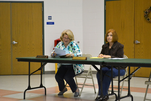 East Quogue Business Administrator Elizabeth Lev sits alongside District Clerk Lenore Rezza as the school board approves its 2011-2012 budget.
