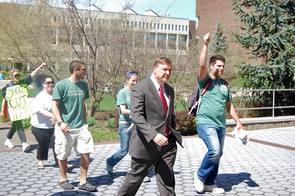 Dr. Samuel L. Stanley. Jr. heads into his office for a discussion with student-leaders. <br>Photo by Brendan O'Reilly