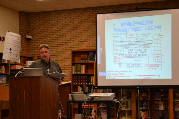 Tom McElrath gave a presentation on the middle school sign to the School Board at its meeting on Tuesday night. LAURA COOPER