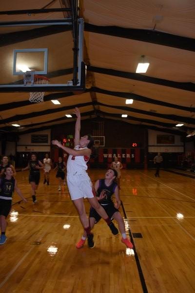 Lady Whaler Katie Kneeland tries to score on a layup. DREW BUDD