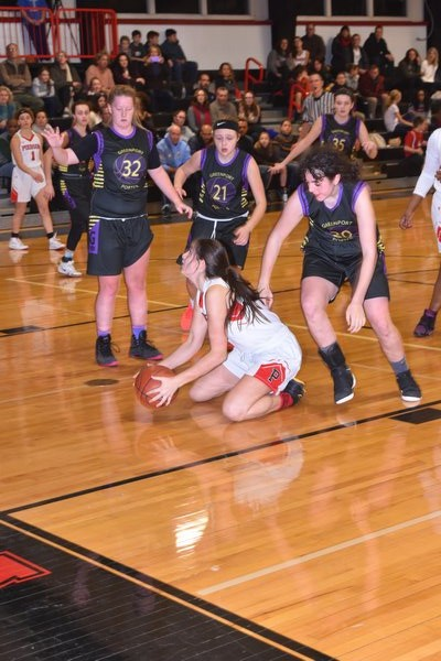 Pierson senior Katie Kneeland picks up a loose ball in front of a trio of Greenport players. DREW BUDD