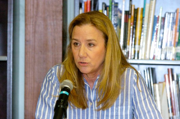 Southampton School Board President Heather McCallion reads from a prepared statement on Friday aftenoon.  DANA SHAW