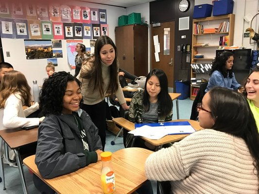 Paula González, pictured second from left, helps students in Sarah Trujillo Underhill's 11th grade class at Southampton High School. COURTESY MARY JANE GREENFIELD