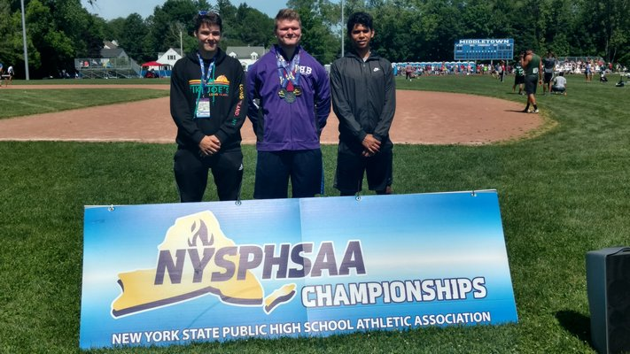 Baymen Thomas O'Connell, left, Quinn Smith and Darwin Fernandez all competed at the New York State Outdoor Track Championships this past weekend. Smith returned home with medals he won in the discus and shot put.