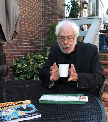 """Allan Zola Kronzek, the author of """"Grandpa Magic,"""" performing card tricks and brain teasers at SagTown in Sag Harbor on Thursday, November 2.   KYRIL BROMLEY"""