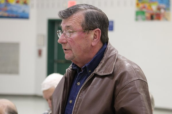East Quogue resident and Air Force veteran John Barron  speaks in favor of a tax exemption for veterans in the East Quogue School District during a public hearing held by the district's board of education Tuesday night. KYLE CAMPBELL