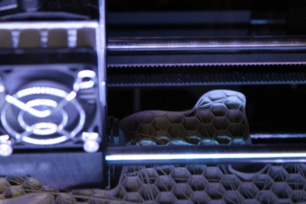 A recently purchased three-dimensional printer at Westhampton Beach High School assembles a plastic protein model layer by layer on Monday afternoon. KYLE CAMPBELL