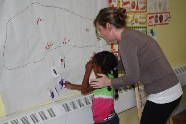 Teacher Happie Palmedo with Bridgehampton Head Start student Mia Silvestre, of East Hampton, played games to celebrate the 45th anniversary of Long Island Head Start last week.