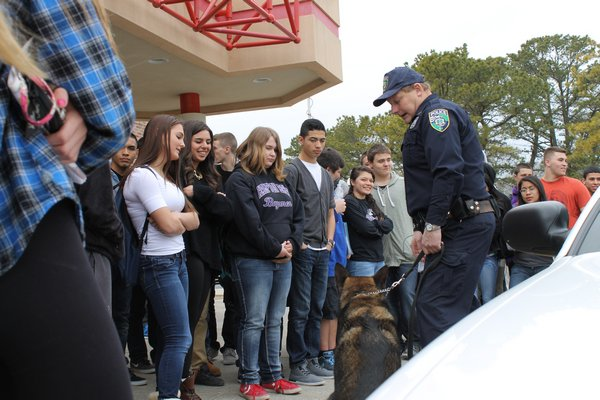 Riverhead Town Police Officer John Doscinski shows off his K-9 partner to Hampton Bays High School students during Friday's Career Day. KYLE CAMPBELL