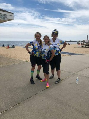 Mitti Ellams, left, Kim Covell and Romi Sloan at the 75-mile mark of their 100-mile ride.