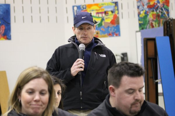 East Quogue resident Joe Amato speaks in favor of piercing the state tax levy cap during a budget presentation at East Quogue Elementary School on Tuesday night. KYLE CAMPBELL