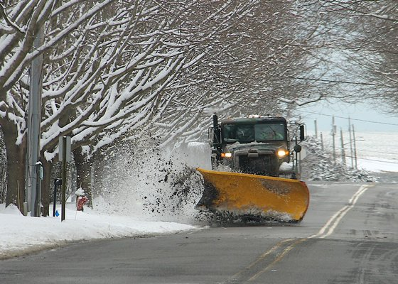 A plow in Amagansett on Friday morning. More snow is expected on Saturday.  KYRIL BROMLEY