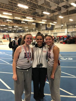 Mimi Fowkes, left, and, JiJi Kramer, right, won the 1,500-meter race walk relay in a combined time of 16:40.26 at the Zeitler Relays. East Hampton girls track head coach Yani Cuesta is also pictured.