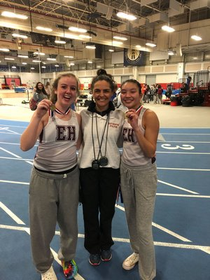 Mimi Fowkes, left, and JiJi Kramer, right, won the 1,500-meter race walk relay in a combined time of 16:40.26 at the Zeitler Relays. East Hampton girls track head coach Yani Cuesta is also pictured.