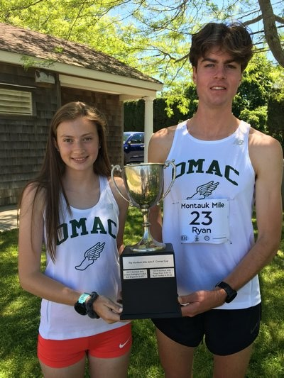 Ava Engstrom and Ryan Fowkes, winners of the third annual Montauk Mile, with the Montauk Mile John Conner Cup. JENNIFER FOWKES
