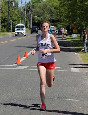 Ava Engstrom was the first to cross the finish line of the women's Montauk Mile on Sunday morning. KYRIL BROMLEY