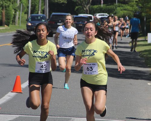Nashaly Penafiel, left, and Daniela Chavez cross the finish line together. KYRIL BROMLEY