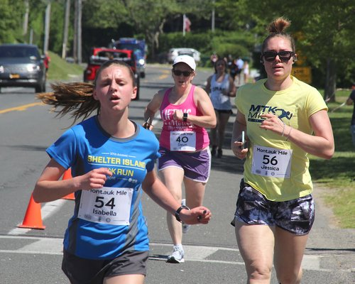 Isabella Sherman of Shelter Island finishes just ahead of Jessica Stich of Sarasota, Florida. KYRIL BROMLEY
