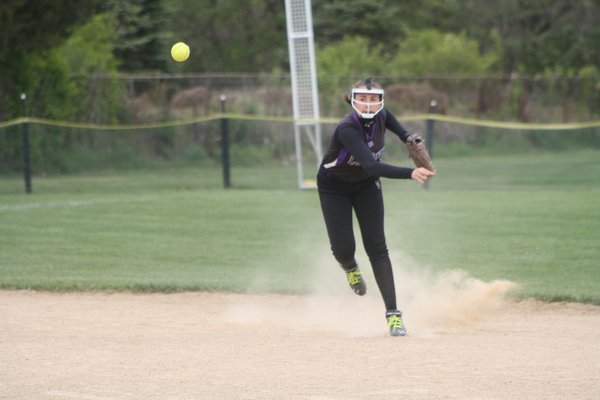 Shortstop Amelia Kozuchowski makes a throw in her team's 4-3 playoff win over Miller Place. CAILIN RILEY