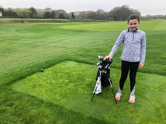 Elie Poremba, 9, of Southampton has been playing golf since she was four years old, and takes lessons with Jason Russell at Southampton Golf Club. She qualified to compete in US Kids Golf Worlds in August. CAILIN RILEY