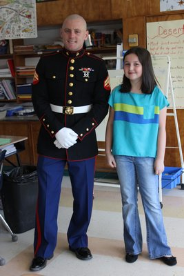 Marine Corporal Jacob Campbell with Jocelyn McNamara, 10,  at the East Quogue Elementary School on Wednesday, April 24. By Carol Moran