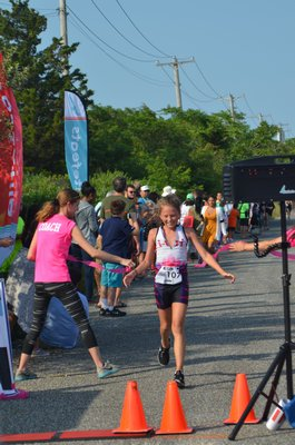 Scout Whiting finishes the Hamptons Youth Triathlon.