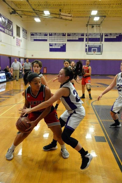 Hampton Bays junior Pam Grajales covers a Center Moriches player. MICHELLE MALONE