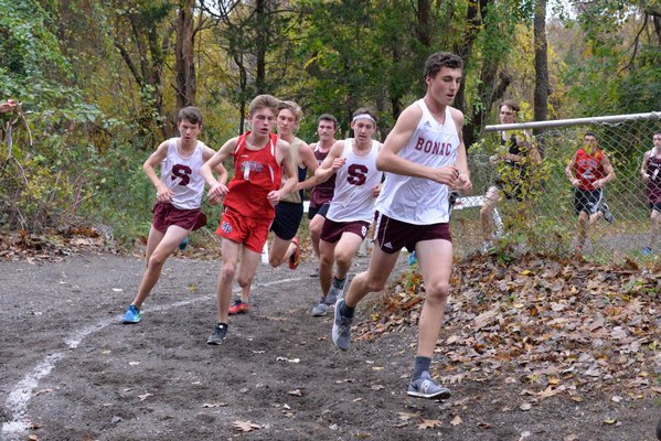 East Hampton senior Ethan McCormac leads a pack of runner early in Friday's race. MICHELLE MALONE