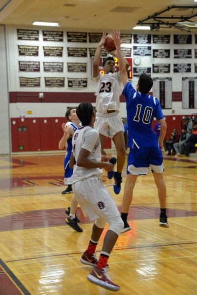 Mariner Marquise Trent pulls up at the top of the key for a jump shot. MICHELLE MALONE
