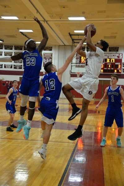 Southampton senior Marcus Trent shoots a fade-away jumper over a pair of Glenn defenders. MICHELLE MALONE