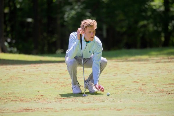 East Hampton senior Turner Foster lines up a shot at the New York State Boys Golf Championships, which were held June 1-3.  PATRICK SHANAHAN PATRICK SHANAHAN