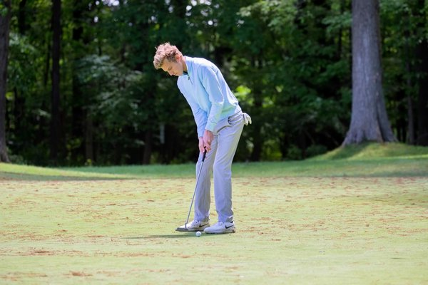 East Hampton senior Turner Foster lines up a shot at the New York State Boys Golf Championships, which were held June 1-3. PATRICK SHANAHAN