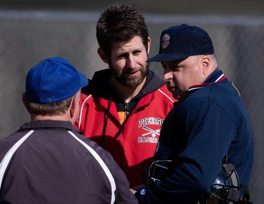 Pierson head coach Jon Schwartz, center, and Mattituck's Gene Rochler meet at home plate prior to the game. CRAIG MACNAUGHTON