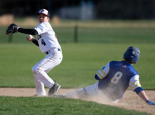 Pierson second baseman Christian Pantina gets the force out at second, but is unable to complete the double play. CRAIG MACNAUGHTON